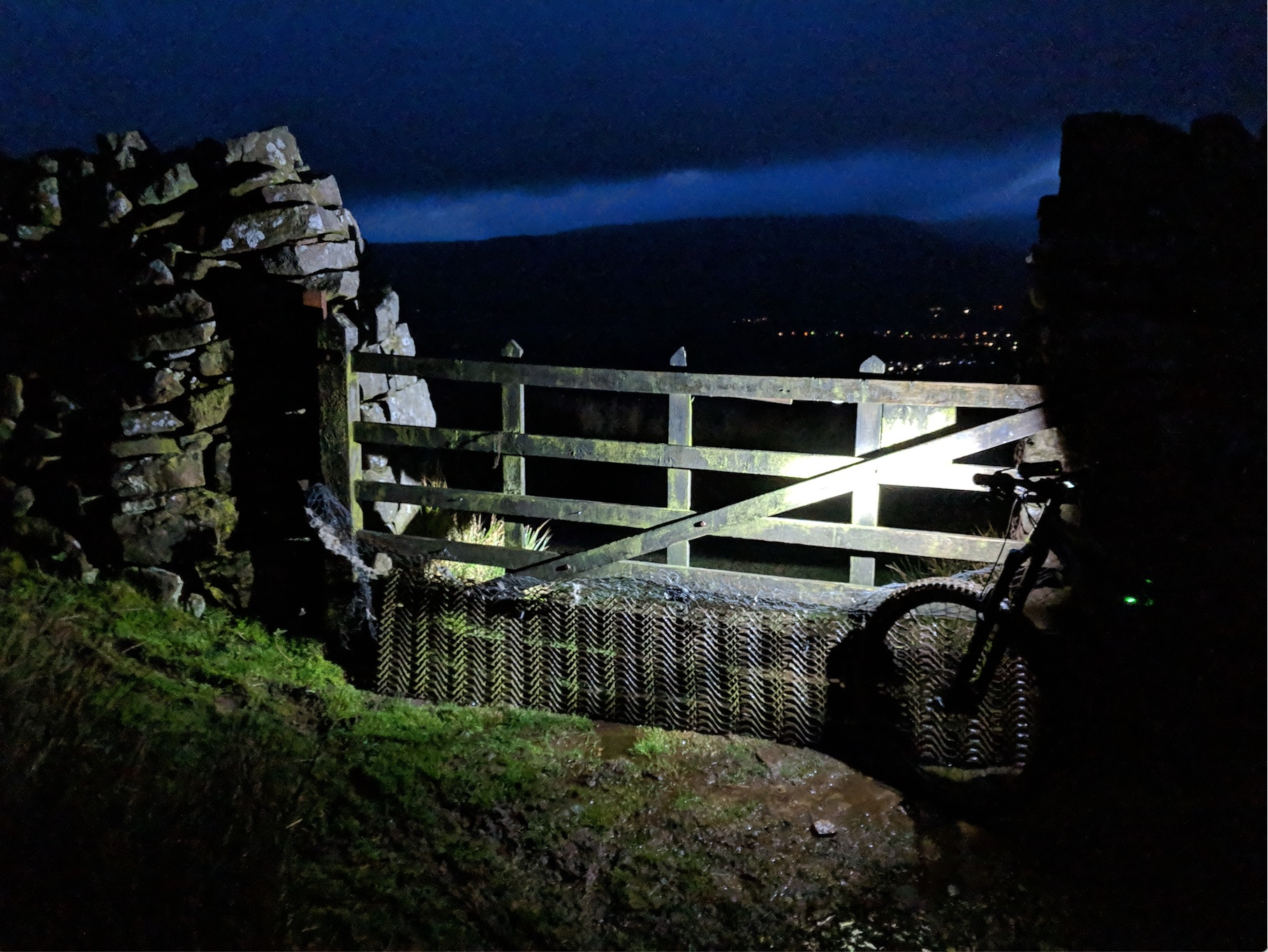 Bike against fence overlooking a starry night